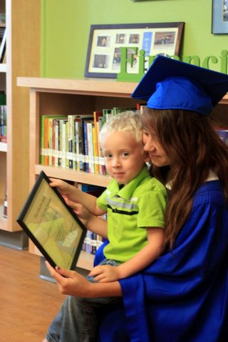 GED grad and child